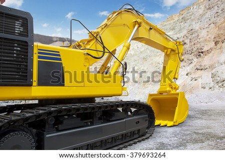Image of a new excavator with yellow color on the construction site, ready to work and excavation - stock photo