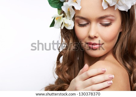 Image of a nude woman with flowers in her hair - stock photo