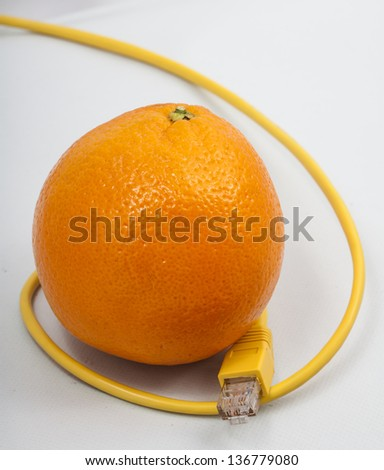 Image of a Orange with ethernet cable - stock photo