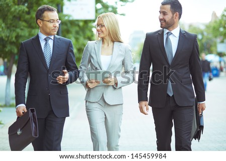 Image of a perfectly combined business team with two confident men and a lovely lady - stock photo