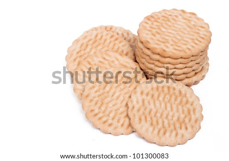 Image of a pile of healthy less calorie cookies over white background on Food and Diet theme/pile of cookies