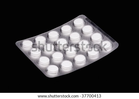 Image of a pills blister  over black background