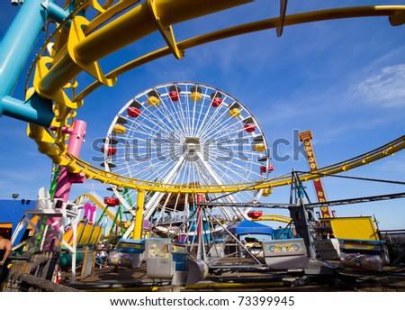 Image of a popular destination; the pier at Santa Monica, CA. with a view of the Ferris Wheel - stock photo