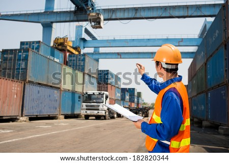 Image of a port inspector controlling cargo distribution  - stock photo