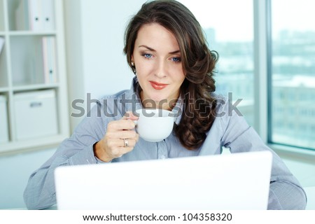 Image of a pretty businesswoman on her usual working day