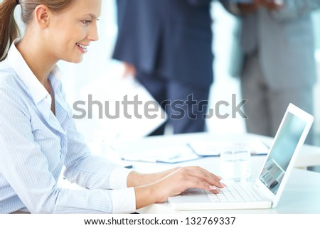 Image of a pretty young lady working in office