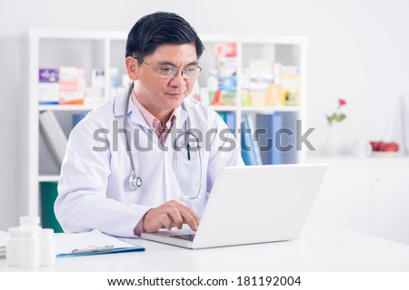 Image of a professional doctor networking at the workplace
