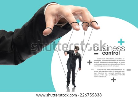 image of a puppet businessman standing on against each other, concept of business control  - stock photo