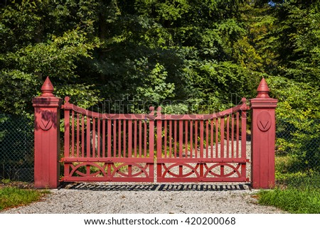 Image of a red ornate wooden gate. - stock photo