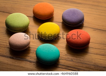 Image of a ring of colorful macaroons on wood