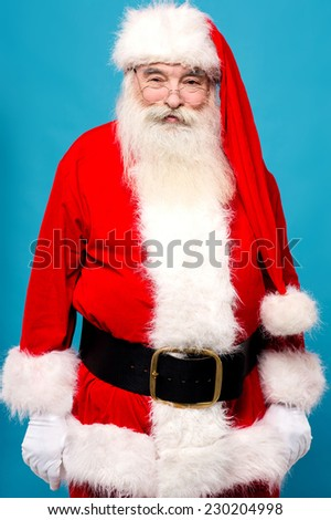 Image of a santaclaus ready to  entertain on xmas eve - stock photo