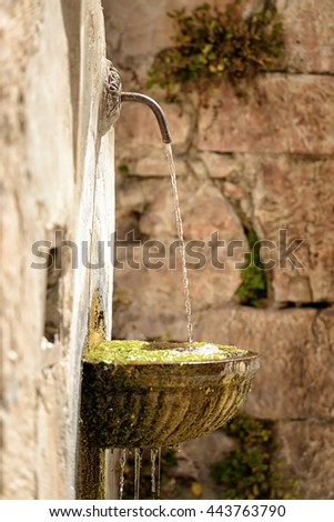 Image of a small fountain in the city Visso in Italy Marche