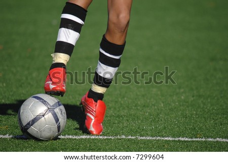 Image of a soccer player touching the ball - stock photo