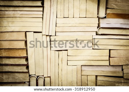 image of a stack of paperback books, vintage style - stock photo