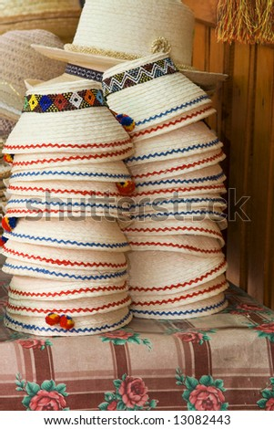 Image of a stack of traditional Romanian hats.