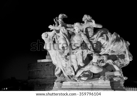 Image of a statue of Victor Emmanuel II bridge with winged victories travertine. Rome at night .
