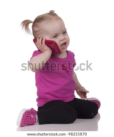 Image of a toddler using a cell phone. - stock photo