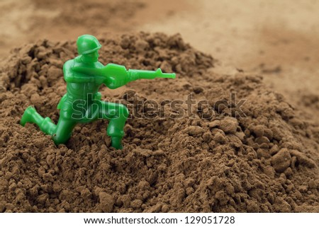 Image of a toy soldier on a chocolate powder - stock photo