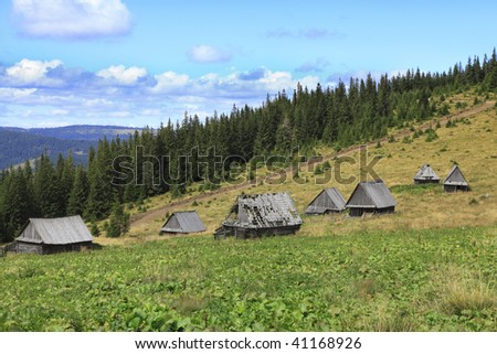 Image of a traditional mountain village in Apuseni Mountains Romania. The houses are made of wood without using a single piece of iron. - stock photo