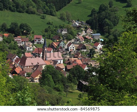 Image of a typical Alsatian village located in a valley near Colmar in Vosges Mountains in north-eastern France. - stock photo