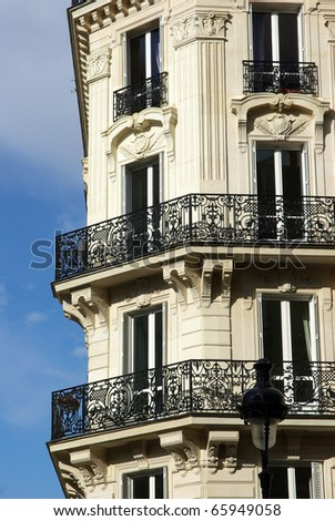 Image of a typical Haussmann building in Paris. - stock photo