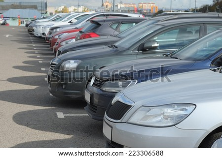 image of a vehicles parked in parking lot - stock photo