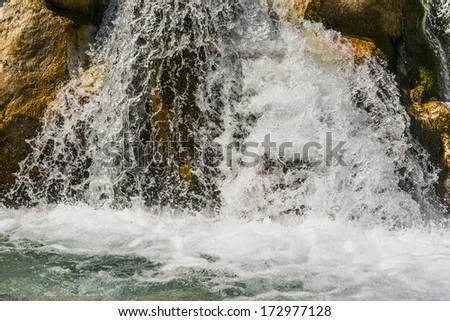 Image of a waterfall in Austrian Alps in summer