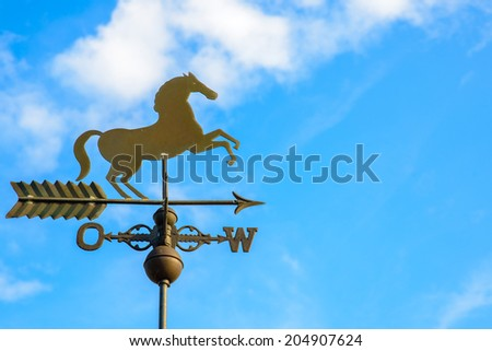 Image of a weather vane in a horse shape pointing west  - stock photo