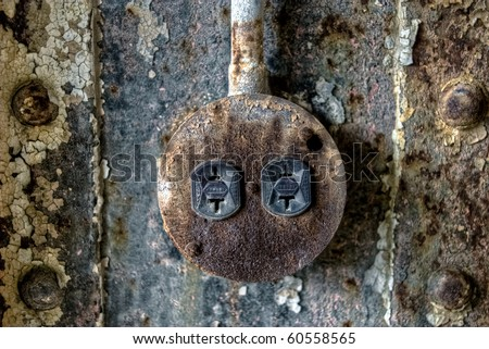 Image of a weathered, dirty, rusty, old electrical power outlet in an industrial abandoned warehouse. - stock photo