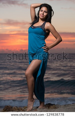 Image of a woman at sunrise on the beach