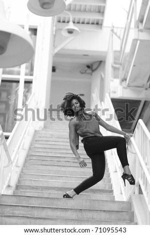 Image of a woman posing on a staircase - stock photo