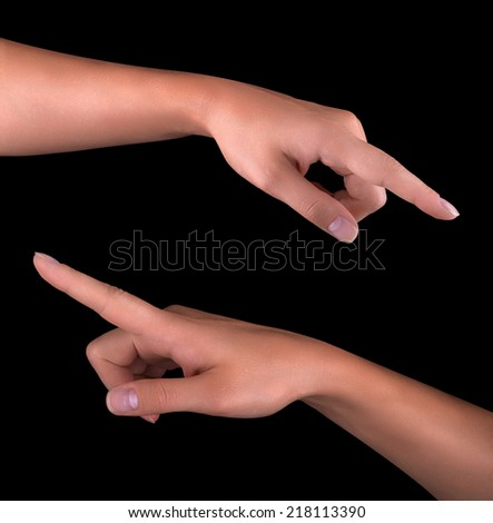 image of a woman's finger pointing  or touching isolated on black background - stock photo