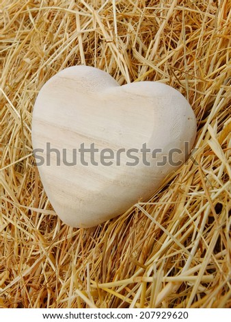 Image of a wooden heart with straw