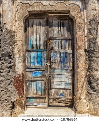 Image of a worn old door, made of planks. Santorini, Greece.  - stock photo