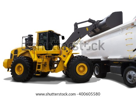 Image of a yellow backhoe using a scoop to load soil into a truck, isolated on white background - stock photo
