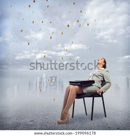 image of a young business woman looking at the falling business signs - stock photo