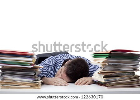 Image of a young businessman sleeping while at work - stock photo