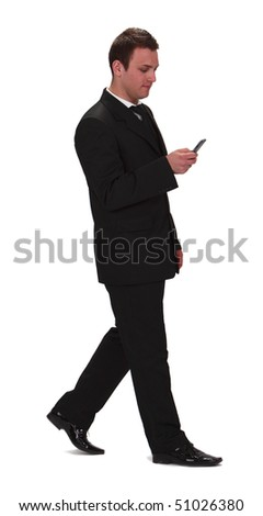 Image of a young businessman walking and checking his mobile phone,isolated against a white background. - stock photo