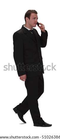 Image of a young businessman walking and using his mobile phone,isolated against a white background. - stock photo