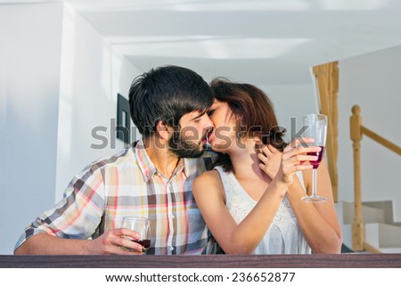 Image of a young couple kissing with passion