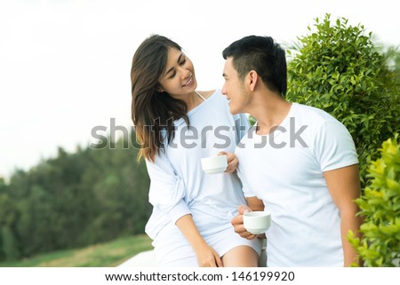 Image of a young couple meeting the morning on the balcony - stock photo