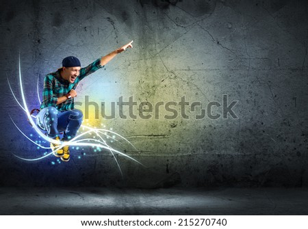 image of a young man dancing hip-hop, collage - stock photo