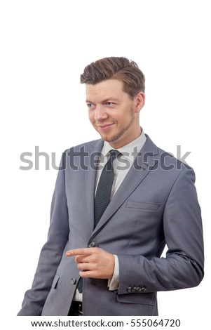 image of a young man in a tie is smiling and pointing her finger