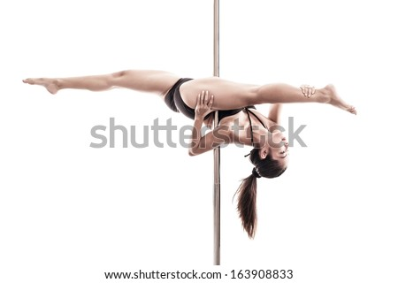 Image of a young professional pole dancer isolated on white