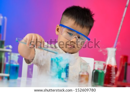 Image of a young researcher making chemical experiments in the lab