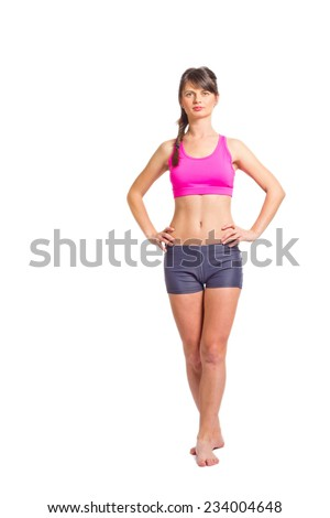 Image of a young sportive girl with definite muscles - isolated on white