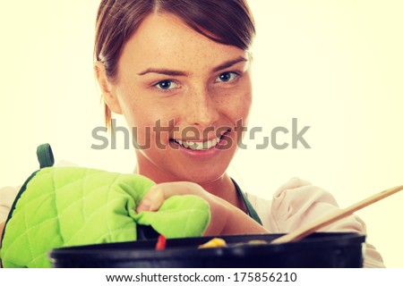 Image of a young woman cooking healthy food - stock photo