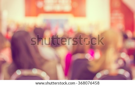 image of abstract blur people looking to kid 's show on stage at school , for background usage . (vintage tone) - stock photo