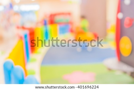 image of abstract blurred kids at indoor public ' s playground  for background usage. (vintage tone) - stock photo