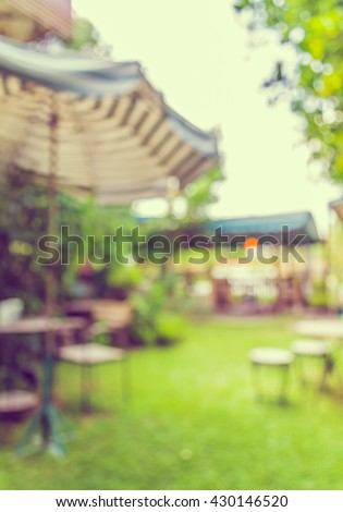 image of Abstract blurred outdoor coffee hut on day time in garden for background usage . (vintage tone) - stock photo
